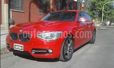 Foto venta Auto Usado BMW Serie 1 118i 5P (2012) color Rojo precio $780.000