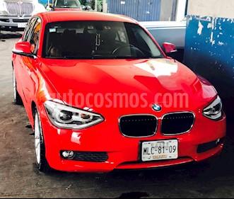 BMW Serie 1 5P 118iA usado (2012) color Rojo precio $210,000