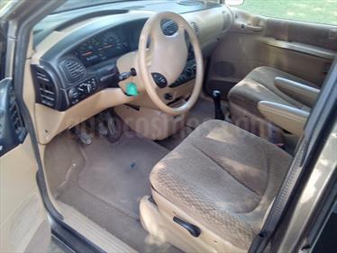Foto venta Auto Usado Chrysler Caravan 2.4 SE  (1999) color Marron Chispeante precio $130.000