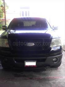 Foto venta carro usado Ford F-150 Supercab Auto. 4x4 (2006) color Negro Ebano y Plata Metalizado precio u$s5.000