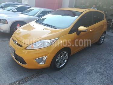 Foto venta Auto Seminuevo Ford Fiesta Hatchback SES Aut (2012) color Amarillo Mostaza precio $135,000