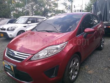 Foto venta Carro Usado Ford Fiesta Sedan Sportback (2012) color Rojo Caramelo precio $30.000.000
