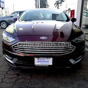 Foto venta Auto nuevo Ford Fusion SE LUX Hibrido color Vino Tinto precio $603,200