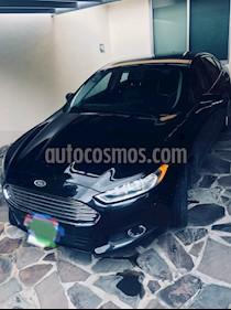 Foto venta Auto Seminuevo Ford Fusion SE Luxury (2014) color Negro Profundo precio $230,000