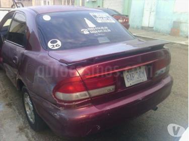 Foto venta carro usado Ford Laser GLX Auto. (1999) color Rojo precio BoF6.000.000