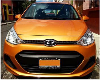 Foto venta Auto Seminuevo Hyundai Grand i10 GL MID (2016) color Naranja Dinamico precio $142,800