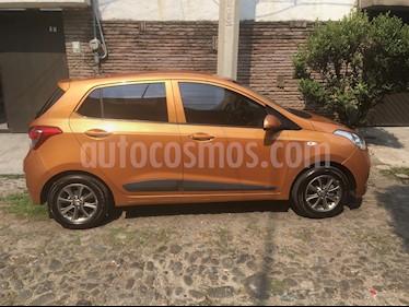 Foto venta Auto Seminuevo Hyundai Grand i10 GLS (2015) color Naranja precio $130,000