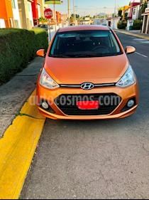 Foto venta Auto Seminuevo Hyundai Grand i10 GLS (2017) color Naranja precio $151,900