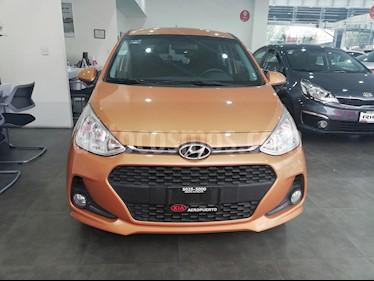 Foto venta Auto Seminuevo Hyundai Grand i10 GLS (2018) color Naranja Cobre precio $195,000