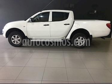 Foto venta Auto Usado Mitsubishi L200 4x2 2.5L DI-D Cabina Doble (2015) color Blanco precio $220,000