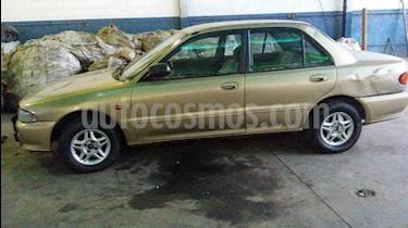 Foto venta carro usado Mitsubishi Lancer GLXi  Sinc. (1998) color Bronce precio u$s750