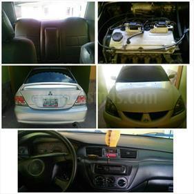 Foto venta carro Usado Mitsubishi Lancer Touring Sinc. (2005) color Acero precio u$s3.700