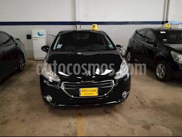 Foto venta Auto Usado Peugeot 208 1.5 N 8v Allure Nav. (L16) (2013) color Negro precio $295.000