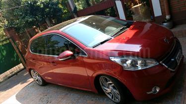 Foto venta Auto Usado Peugeot 208 Feline 1.6 Pack Cuir (2014) color Rojo Lucifer precio $270.000