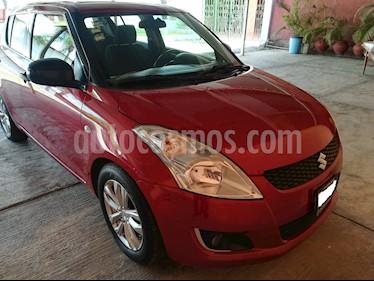 Foto venta Auto usado Suzuki Swift GA (2013) color Rojo precio $125,000