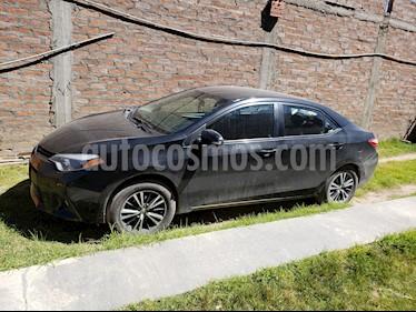 Toyota Corolla  1.8 Full Aut climatizador  usado (2016) color Negro precio $15,500