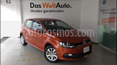 Foto venta Auto Seminuevo Volkswagen Polo 1.6L Base 4P (2018) color Naranja Metalico precio $230,000