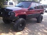 Foto venta carro Usado Jeep Grand Cherokee Laredo 4x4 (92l) V8,5.2i,16v A 1 2 (1998) color Rojo Adrenalina precio u$s4.500