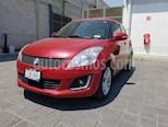 Foto venta Auto Seminuevo Suzuki Swift GLX (2017) color Rojo Rock
